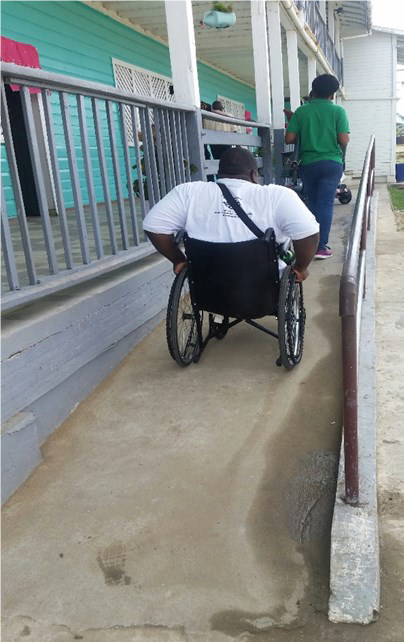 NCD's Commissioner Hilton Morris testing ramp & toilet are on Feb. 14th , 2018 at Fort Ordnance Primary School